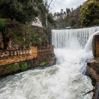 Psyrtskha waterfall and lake