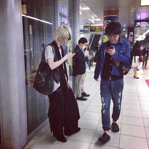 The typical Japanese citizens. Everybody are checking their social networks and messengers.
