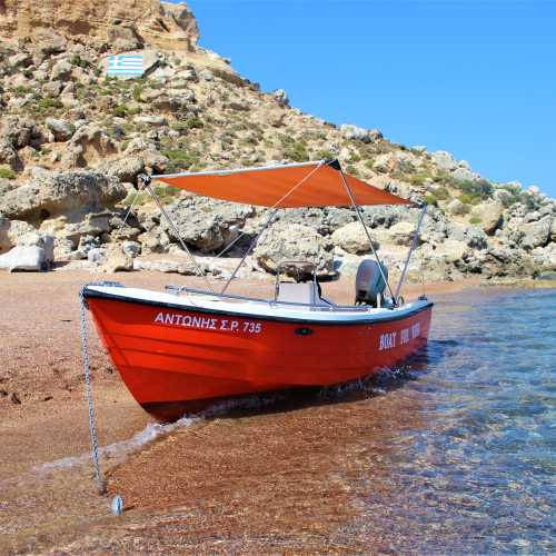 Boat on Red Sand Beach